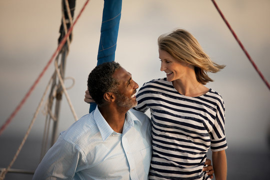 Couple looking at each other lovingly on boat.