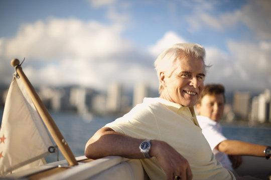 Portrait of mature man leaning back, taking a break on a boat.