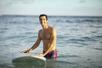 Surfer enjoying being in the sea.