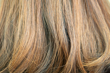 Background of hair dyed color with highlight technique but makes hair damaged and coarse