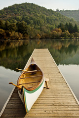 Canoe on a lake pier in autumn.