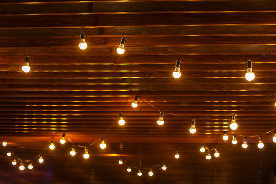 light bulbs on wooden background,