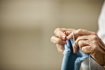 Close-up of elderly woman's hands as she knits.