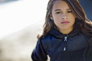 Young girl looking at camera.