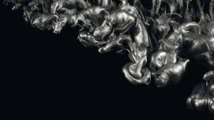 Silver ink in water shooting with high speed camera. Paint dropped, reacting, creating abstract cloud formations and metamorphosis on black. Art backgrounds.