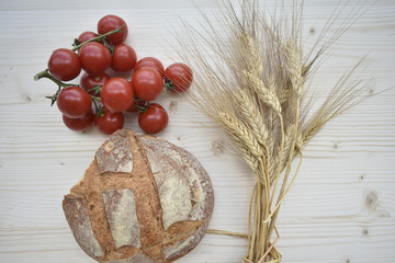 Fresh Bread and Tomatos On Wooden Background