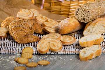 Various kinds of bread and  bakery products on table