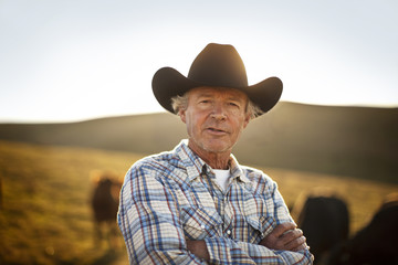 Portrait of a rancher on a paddock.