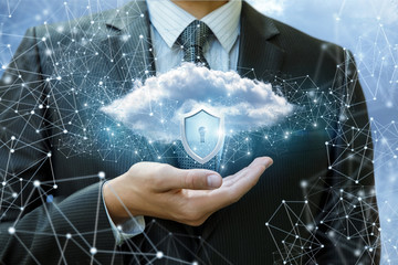 Data cloud with a protective shield in the hand.