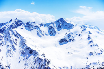 Snow capped summit of Elbrus high under clear blue panoramic skies
