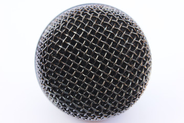 Top view of microphone. Black modern microphone isolated on white background.