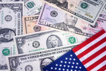 The stars and stripes with dollar bills of the USA. Money, cash background. Financial concept.
