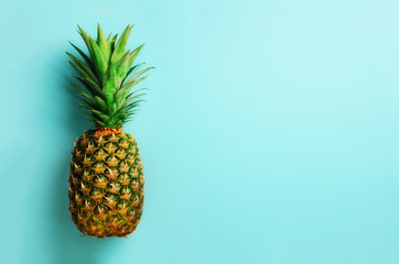 Pineapple on blue background. Top View. Copy Space. Pattern for minimal style. Pop art design, creative concept