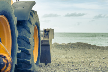Part of the bulldozer, construction equipment on the beach