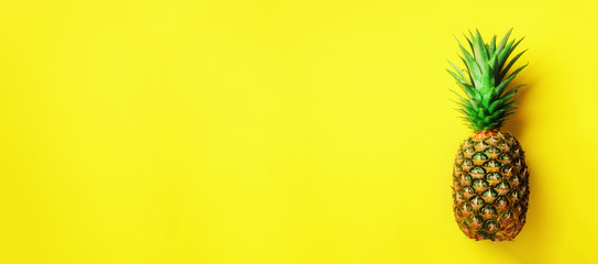Pineapple on yellow background. Top View. Copy Space. Pattern for minimal style. Pop art design, creative concept. Banner