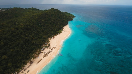 Aerial view of beautiful tropical island with with azure water, Boracay. Tropical lagoon with turquoise water. Beautiful tropical beach on the island. Seascape: Beautiful view of the rock in the sea