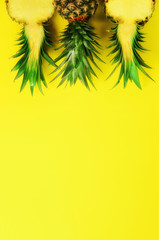 Pattern with bright pineapples on yellow background. Top View. Copy Space. Minimal style. Pop art design, creative summer concept.