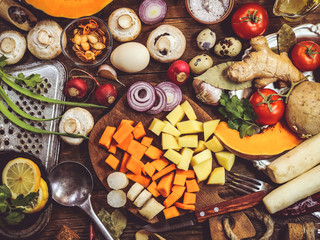mushrooms, pumpkin and potatoes. cooking healthy food. spices and ingredients. wooden background.