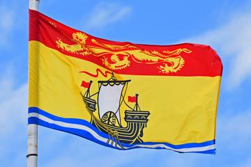 Flag of New Brunswick on blue sky. Photo taken in Saint John in New Brunswick, Canada.
