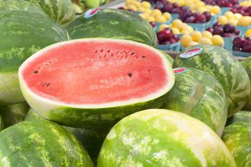 Fresh Watermelon  Cut in Half on Display in Farmer's Market.  Grown in Hermiston, Oregon, USA