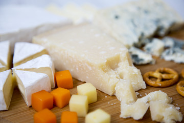 Tasty cheese on wooden board. Closeup