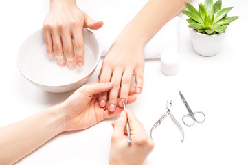 Foto op Plexiglas Manicure Hands care in the spa. Beautiful woman's hands with perfect manicure