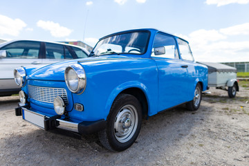German trabant car stands on a street Wall mural