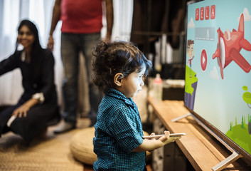 Young Indian boy watching television