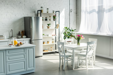 interior of modern light kitchen during sunny day