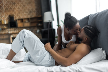 african american couple kissing in bedroom