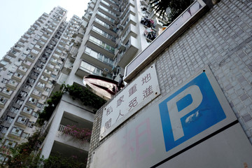 The entrance of a car park at a private property development, where insurance agent Esther Fan has bought a parking spot as an investment, is pictured in Hong Kong