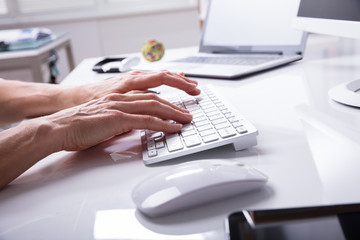 Businessperson Typing On Computer Keyboard