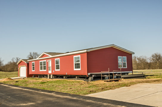 Red Vinyl Siding on New Manufactured Home