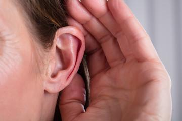 Female Hand On An Ear