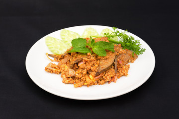 Spicy minced pork salad with vegetables on plate.Spicy minced pork salad with  vegetables on plate.Spicy minced pork salad is a local dish of people in northeast and northern Thailand.