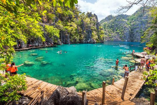 Palawan, Philippines - March 29, 2018. People tourists swimming at Kayangan Lake in Coron Island, Palawan, The Philippines.