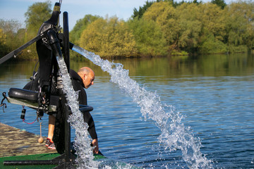 Thriller seeker's jet pack for jet lev or jet levitation waits by the lakeside.