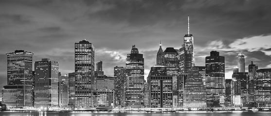 Black and white panoramic picture of Manhattan skyline at night, New York City, USA.