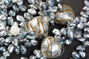 Vintage pearl necklace on black background