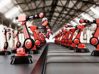 Robotic arms standing in a line inside a factory. 3D illustration