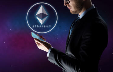 business, cryptocurrency and future technology concept - close up of businessman with transparent smartphone and virtual ethereum symbol hologram over ultra violet space background