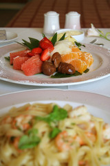 Fruit salad dessert with pasta