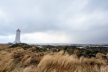 Old lighthouse in Iceland on the edge of the cliff