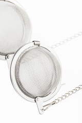 Two tea mesh on a chain on a white background.