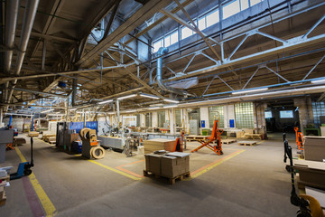 production, manufacture and woodworking industry concept - furniture factory workshop