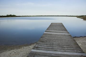 Wooden plank bridge to the lake