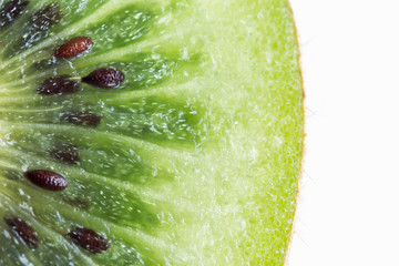 Fresh and juicy kiwi fruit with cross section cut in close up view macro concept to present pattern and texture for background. Kiwi have sweet and sour taste have high vitamin c and antioxidant.