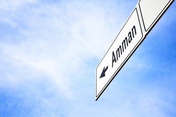 Signboard pointing towards Amman