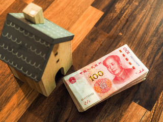 Chinese one hundred Yuan banknotes with wooden model house