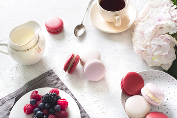 Spaing mood with color macaroons? cup of coffee and flowers